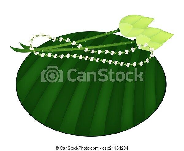 Lotus And Jasmine Garland On Green Banana Leaf