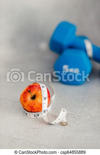 lourd, mesurer, dumbbells, pomme, surface, béton, bande - csp64855889