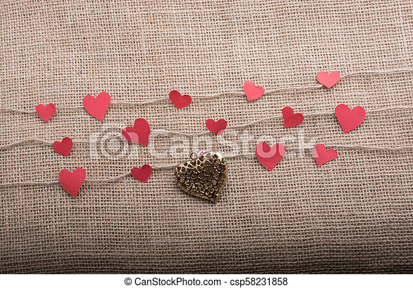 Love concept with heart shaped icons on threads - csp58231858