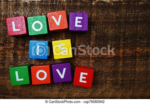 Love is Love word colorful alphabet letter with space copy on wooden background - csp76580942
