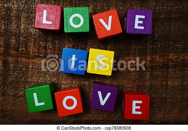 Love is Love word colorful alphabet letter with space copy on wooden background - csp76580938