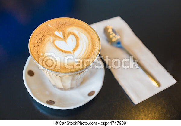 Love latte art coffee on wooden table, valentines day concept