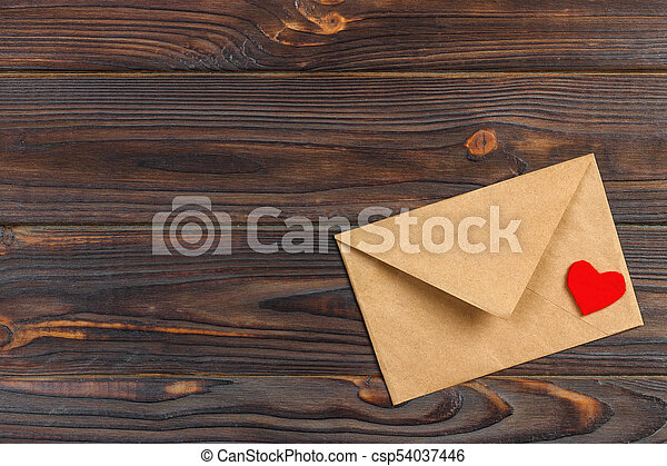love letter envelope with red heart on wooden background. copy space - csp54037446