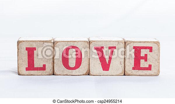Love message written in wooden blocks on white background. - csp24955214