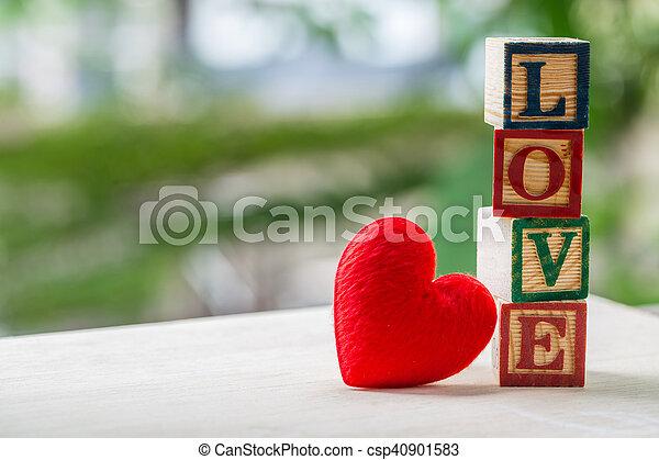 Love message written in wooden blocks. - csp40901583