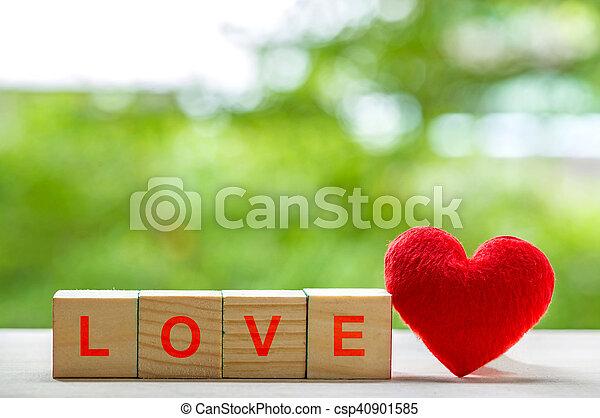 Love message written in wooden blocks. - csp40901585