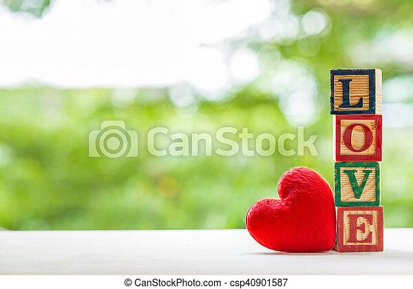 Love message written in wooden blocks. - csp40901587
