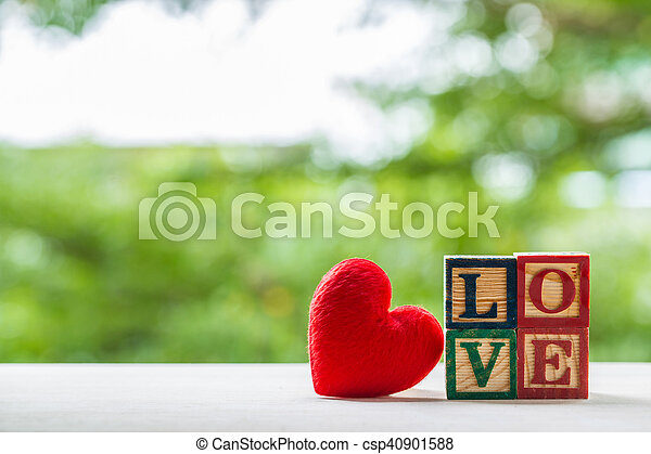 Love message written in wooden blocks. - csp40901588