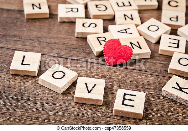 Love message written in wooden blocks. - csp47358559