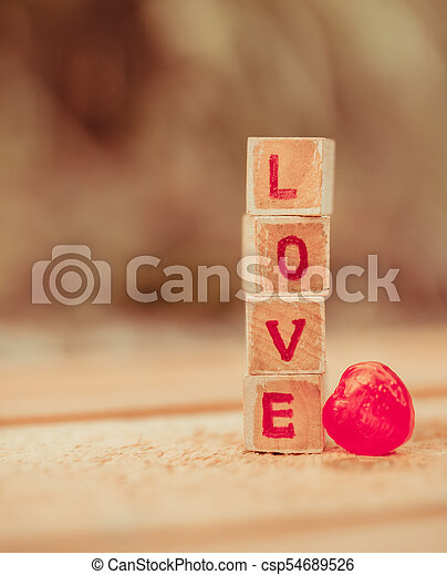 Love message written in wooden blocks. - csp54689526