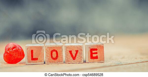 Love message written in wooden blocks. - csp54689528
