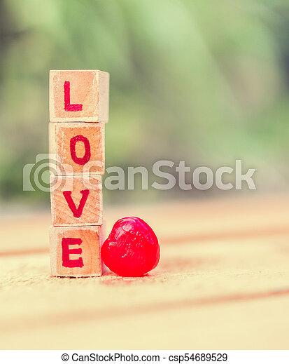 Love message written in wooden blocks. - csp54689529