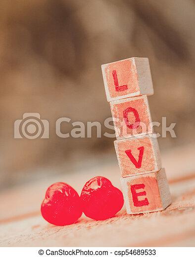 Love message written in wooden blocks. - csp54689533