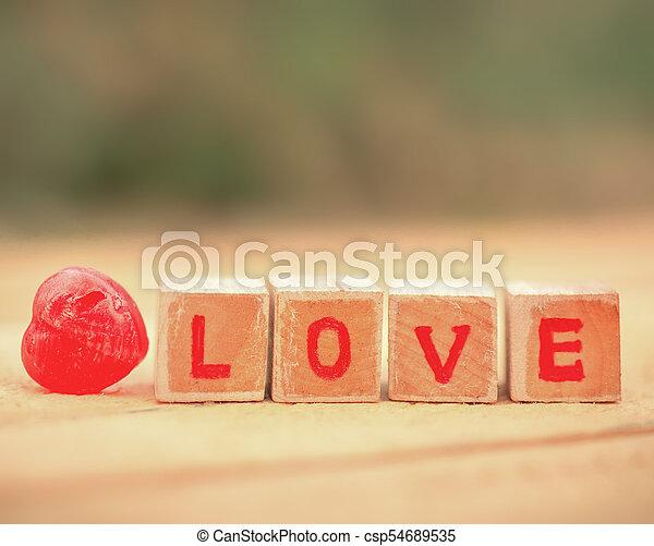 Love message written in wooden blocks. - csp54689535