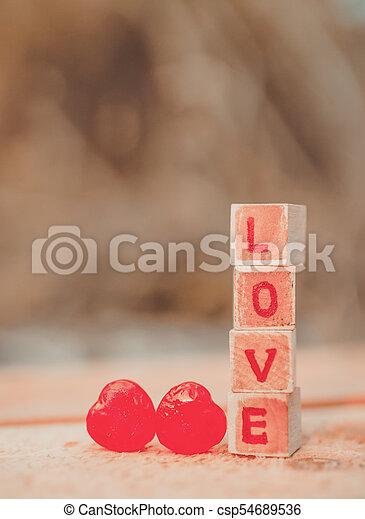 Love message written in wooden blocks. - csp54689536