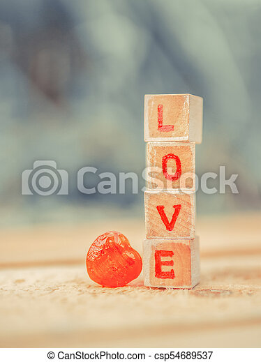 Love message written in wooden blocks. - csp54689537