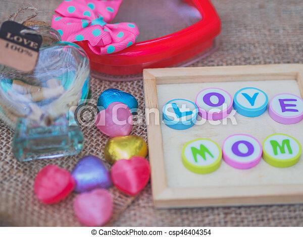 love mom spelled with colorful alphabet blocks - csp46404354