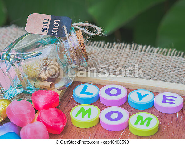 love mom spelled with colorful alphabet blocks - csp46400590
