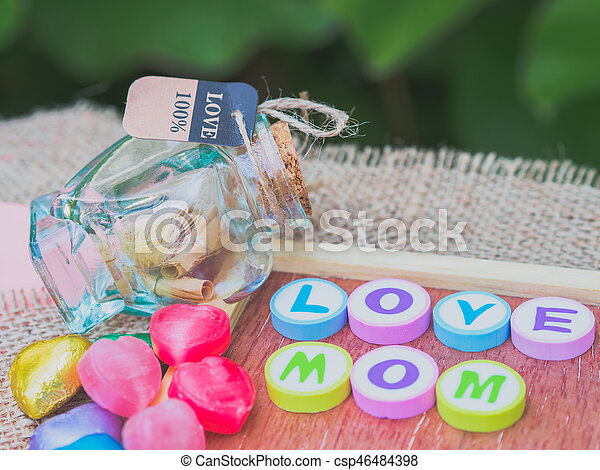 love mom spelled with colorful alphabet blocks - csp46484398