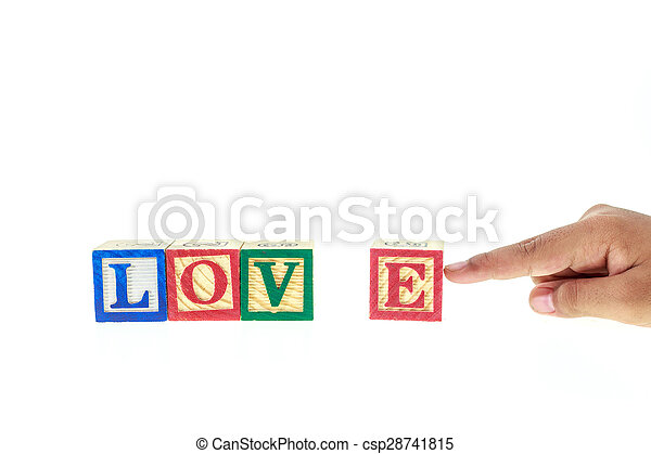 LOVE written in colorful alphabet blocks isolated on white - csp28741815