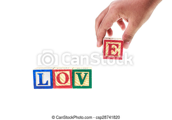 LOVE written in colorful alphabet blocks isolated on white - csp28741820