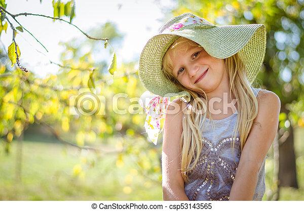 lovely blond girl in hat - csp53143565