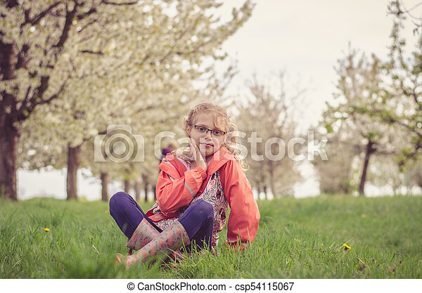 lovely kid in spring nature - csp54115067