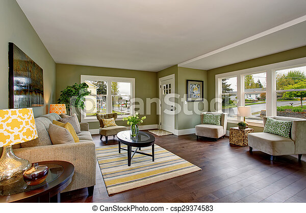 . Lovely living room with green and yellow theme