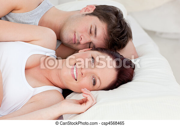 Lovely young couple resting in bed together - csp4568465