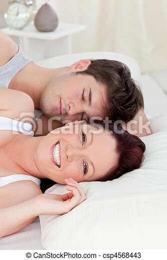 Lovely young couple resting in bed  - csp4568443