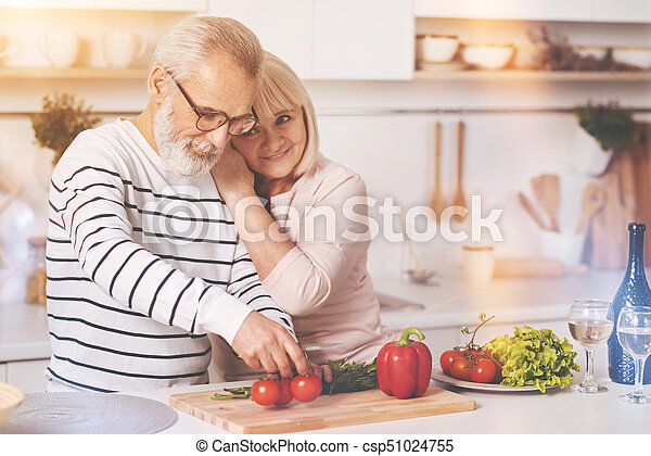Loving aged couple resting in the kitchen - csp51024755