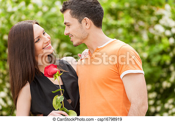 Loving couple. Beautiful young loving couple hugging and looking at each other - csp16798919