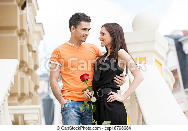 Loving couple. Cheerful young couple hugging while looking at each other - csp16798684
