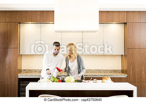 Loving couple in the modern kitchen - csp43750640