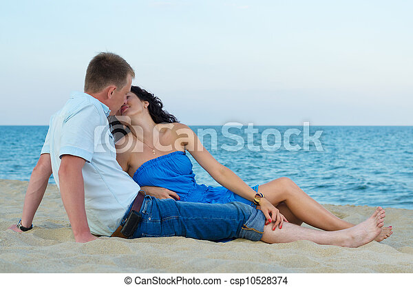 Loving couple kissing on the beach - csp10528374