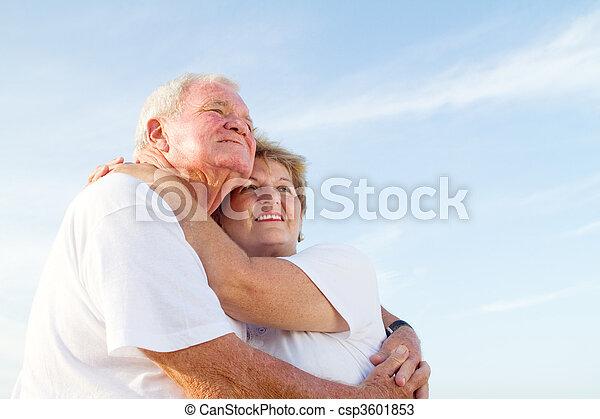 loving elderly couple on beach - csp3601853