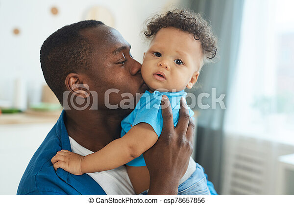Loving Father Kissing Baby - csp78657856