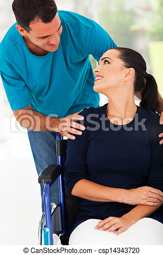 loving husband talking to handicapped wife - csp14343720