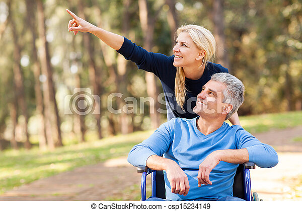 loving mid age wife taking injured husband for a walk - csp15234149