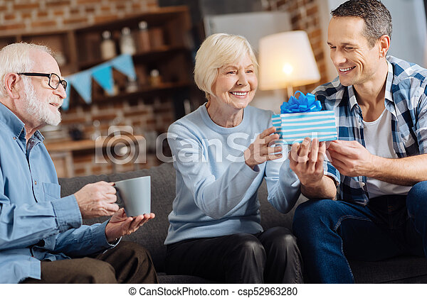 Loving Son Giving A Birthday Present To His Elderly Mother