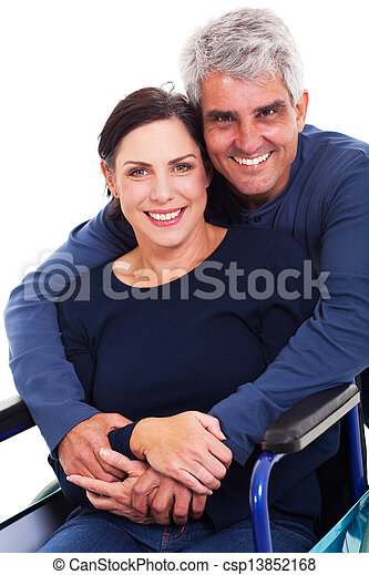 loving supportive husband hugging disabled wife - csp13852168