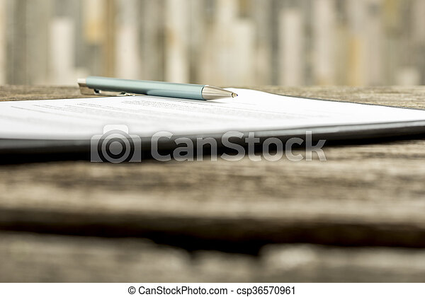 Low angle view of a pen lying on a contract - csp36570961