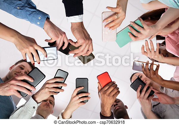 Low Angle View Of Hands Holding Cellphone - csp70632918