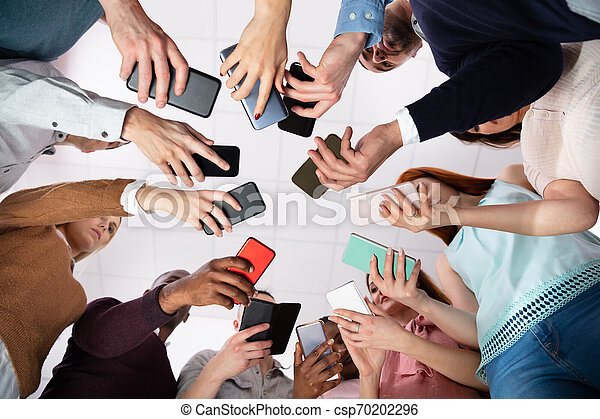 Low Angle View Of Hands Holding Cellphone - csp70202296
