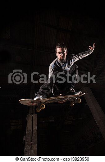 Low angle view of ollie with backside grab trick - csp13923950