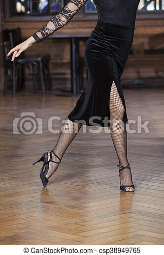 Low Section Of Woman Performing Tango On Hardwood Floor - csp38949765