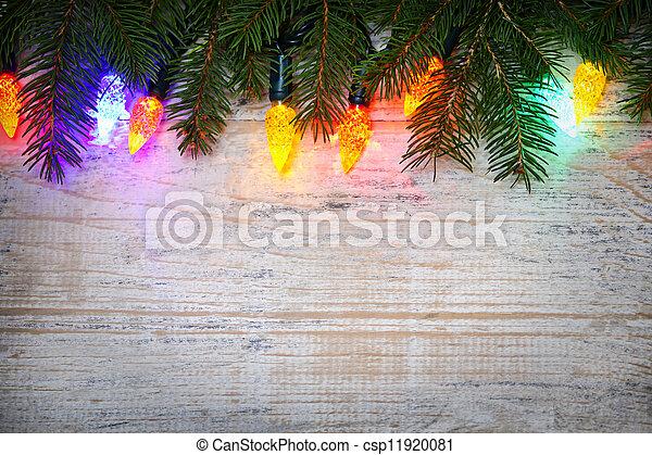 Un fondo navideño con luces en las ramas - csp11920081