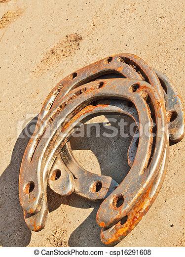 Lucky horseshoe background. - csp16291608