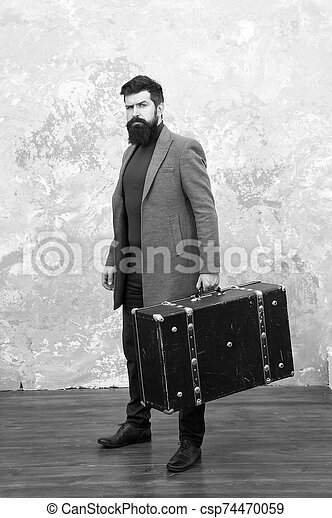 Luggage insurance. Man well groomed bearded hipster with big suitcase. Travel and baggage concept. Hipster traveler with baggage. Ready for relocation with baggage. Start journey. On way to new life - csp74470059