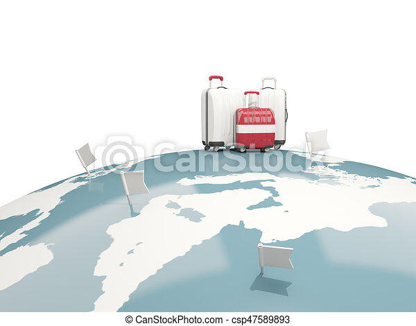 Luggage with flag of latvia. Three bags on top of globe - csp47589893
